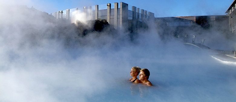 Iceland blue lagoon couple enjoy the thermal waters in Island.