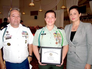 The Military Officers Association of America honored Heritage High School senior Isabella Stringer and fellow cadets during an April ceremony at Patrick Air Force Base. Stringer, of Cuban-American descent, was joined by her mother, Hilda, and her JROTC instructor, First Sergeant Carlos Colon Robles.