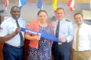 From left to right MSgt Eddie Carr, AFJROTC Instructor, Ms. Alexander Hernandez, Principal, Lt Col Ralph Gracia, AFJROTC Unit Commander, and Mr. Peter Ng-A-Fook, Assistant Principal