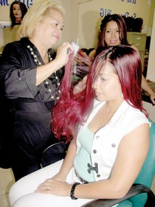 Vicky Torres teaches one of her sudents hair cutting techniques at  Adonai's Beauty School, located at 2020 Palm Bay Rd NE # 6, Palm Bay, FL 32905.