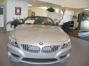 Mundy Burruezo shows a convertible BMW to Renee Dupont at the Melbourne BMW dealership located at 1432 S. Harbor City Blvd., Melbourne, FL 32901.